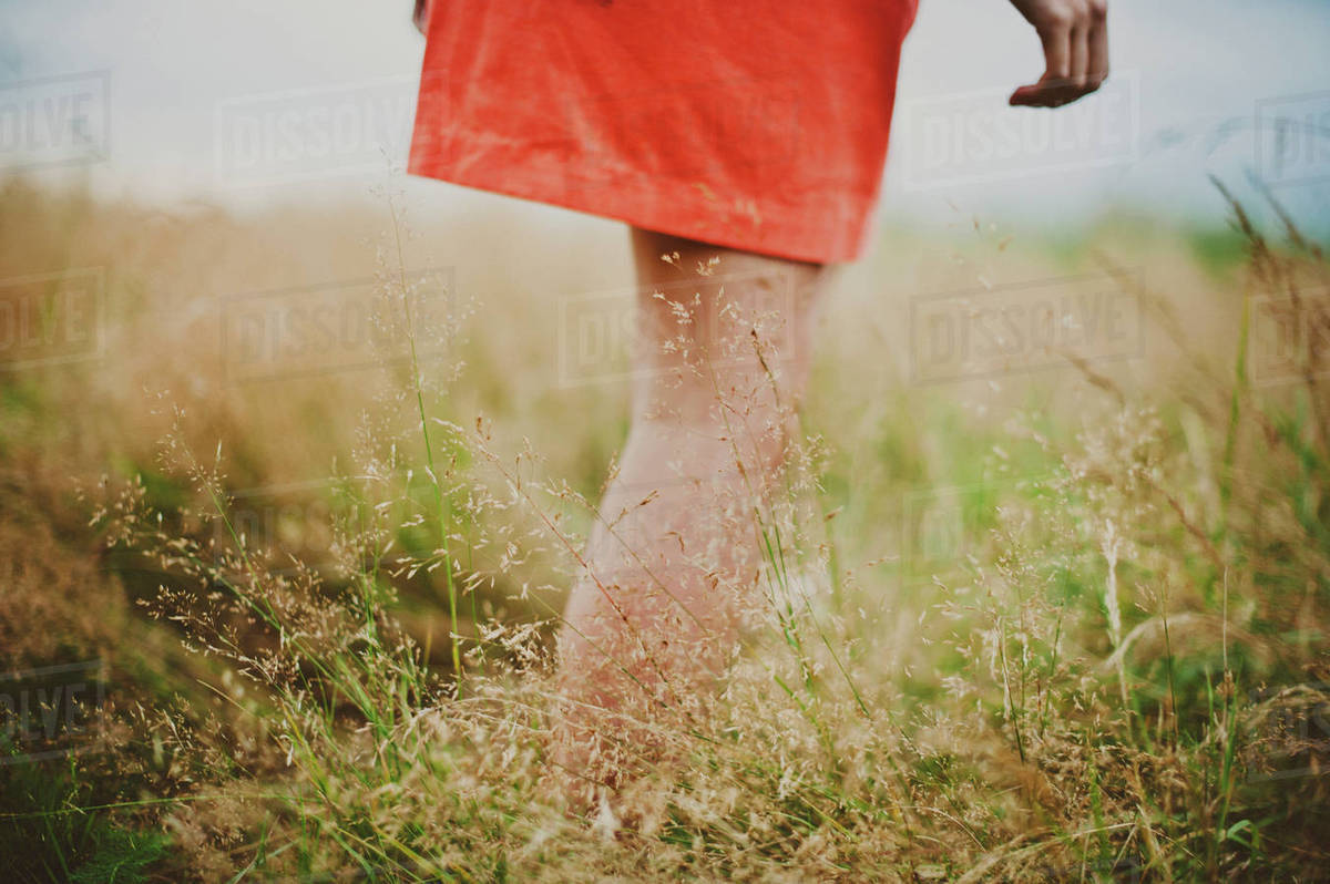 Midsection of girl walking on field Royalty-free stock photo