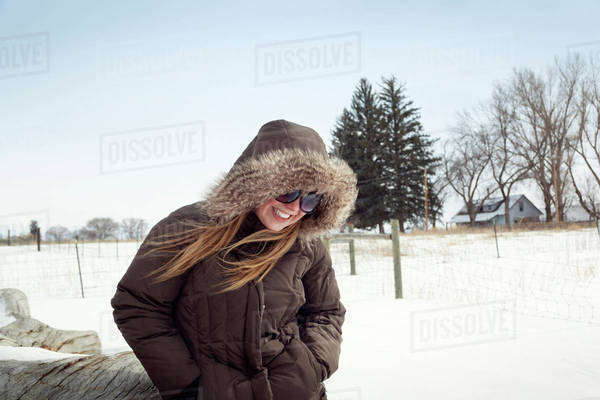 Woman laughing in snowy field Royalty-free stock photo