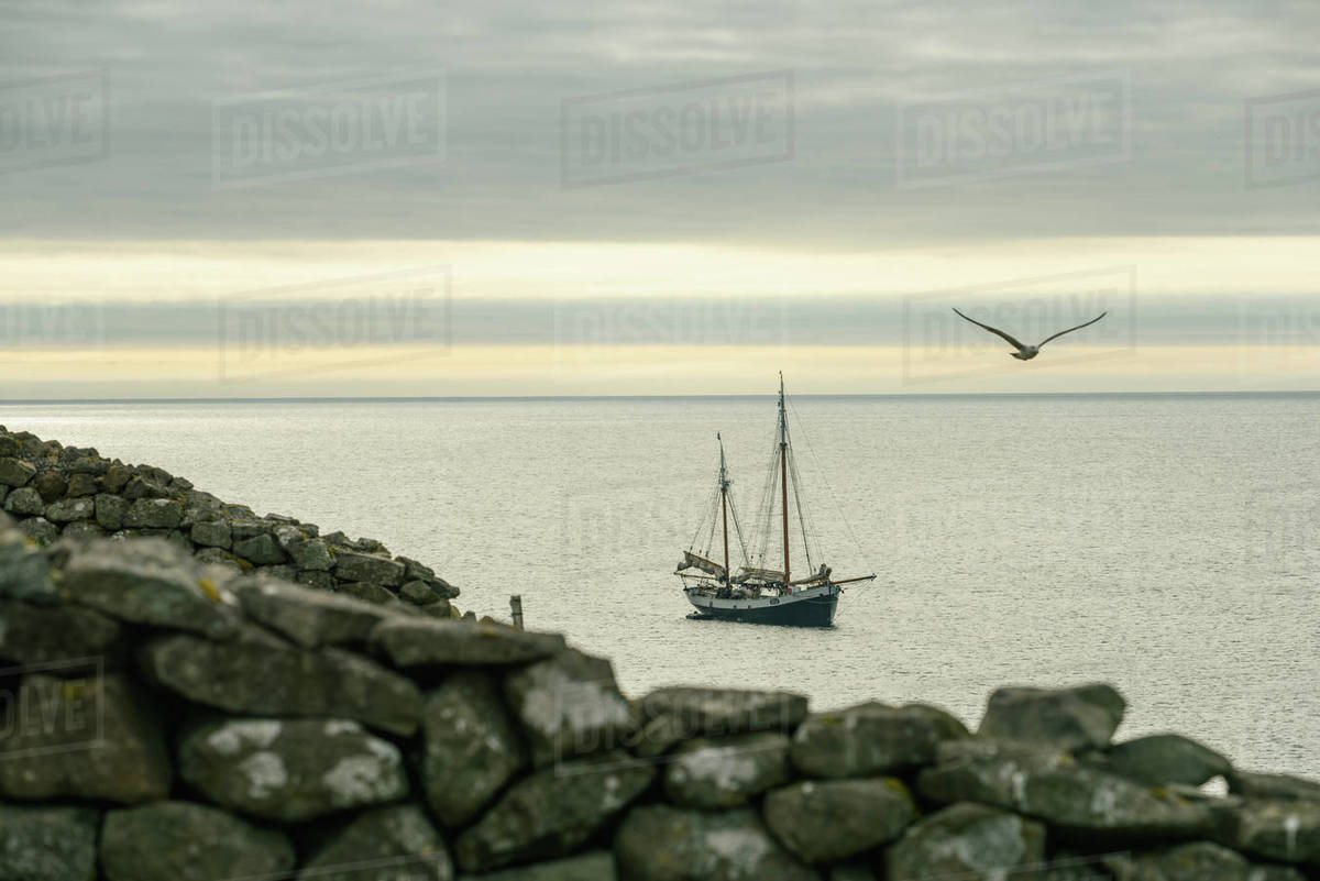 Ship floating on sea at sunset Royalty-free stock photo
