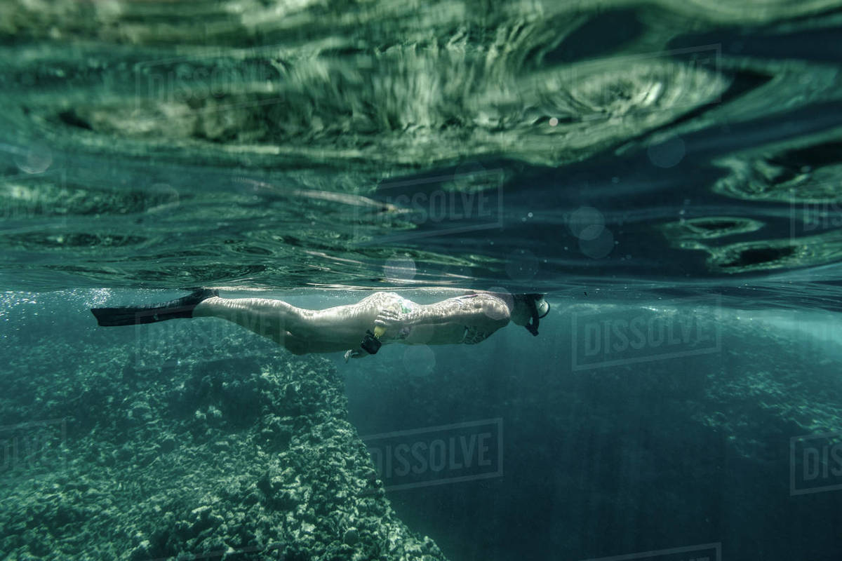 Adult Female snorkeling in clear water in hawaii Royalty-free stock photo