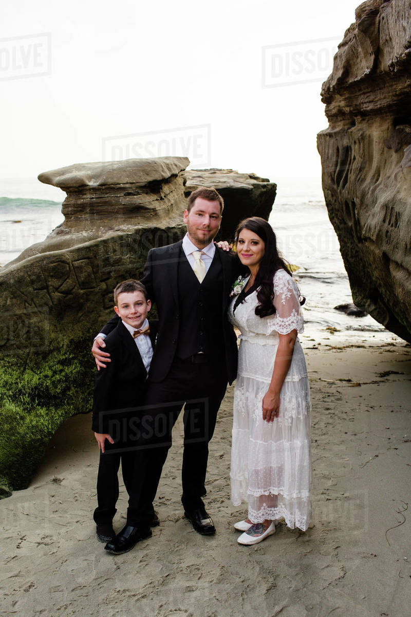 Newlyweds Posing with Nine Year Old Son on Beach in San Diego Royalty-free stock photo