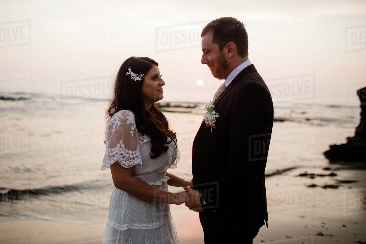 Newlyweds Posing on Beach at Sunset in San Diego Royalty-free stock photo
