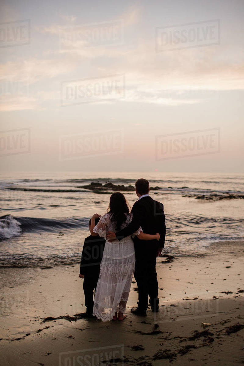Newlyweds & Nine Year Old Son on Beach at Sunset in San Diego Royalty-free stock photo