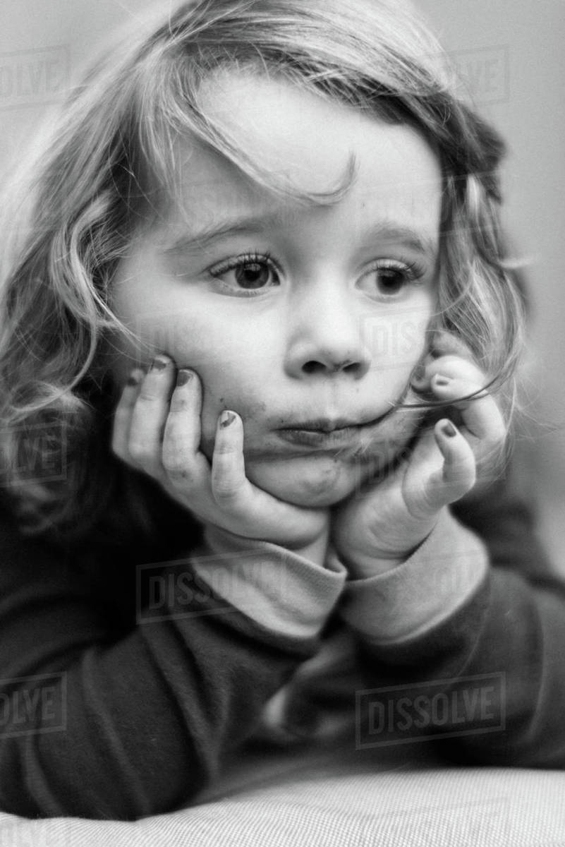 Little toddler girl with a chocolate smeared mouth Royalty-free stock photo