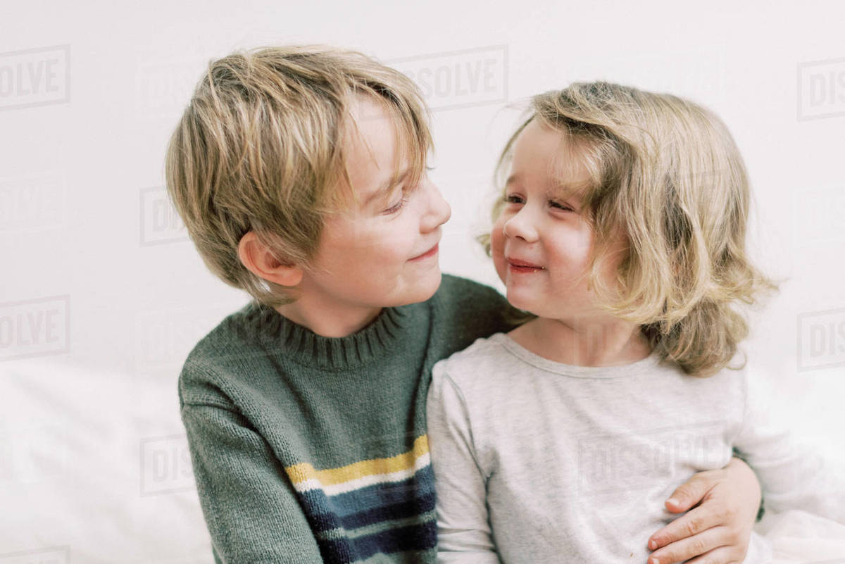 A brother and sister sharing a sweet and happy moment Royalty-free stock photo
