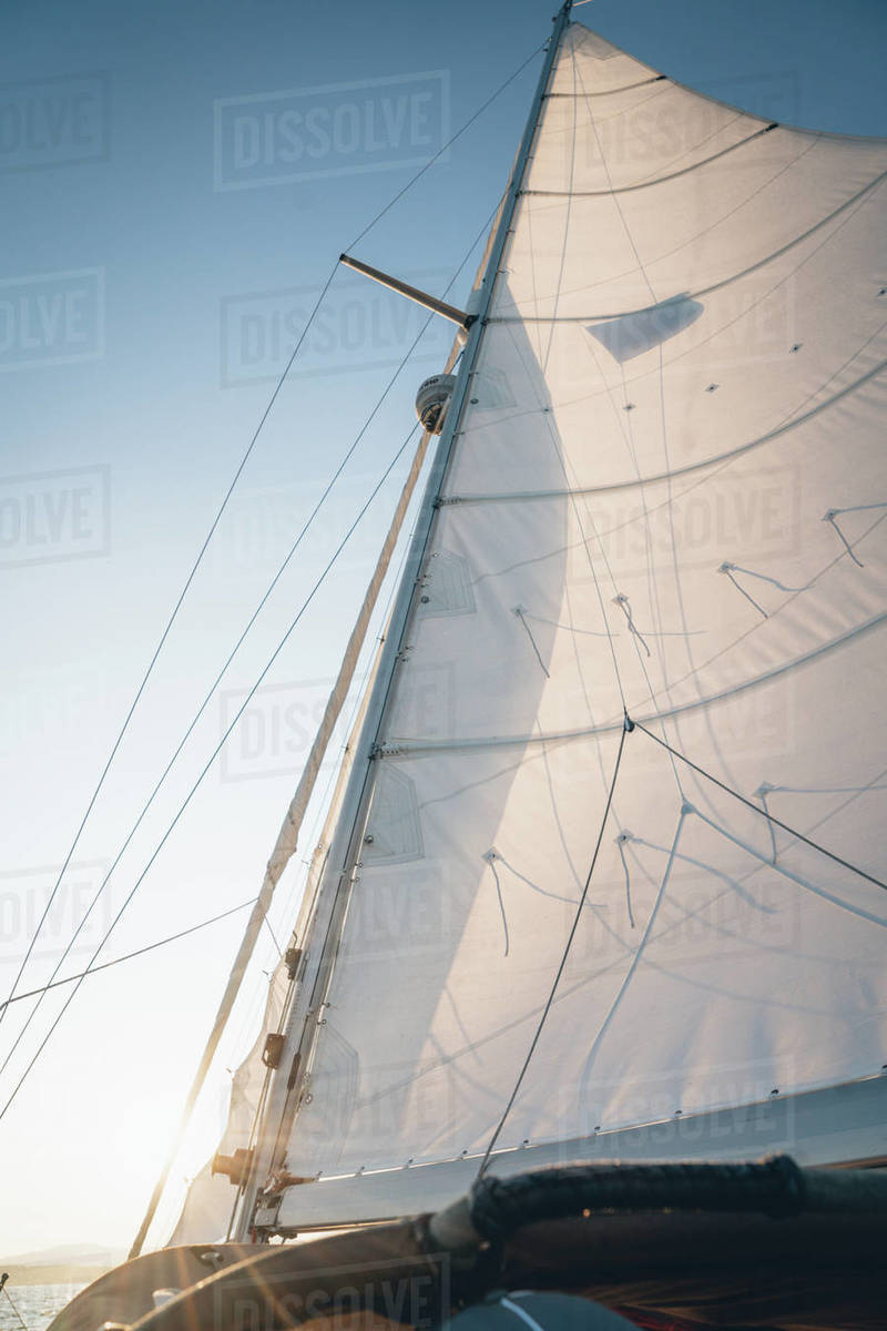 The mast of a sailboat sailing in Maine during late-day Royalty-free stock photo