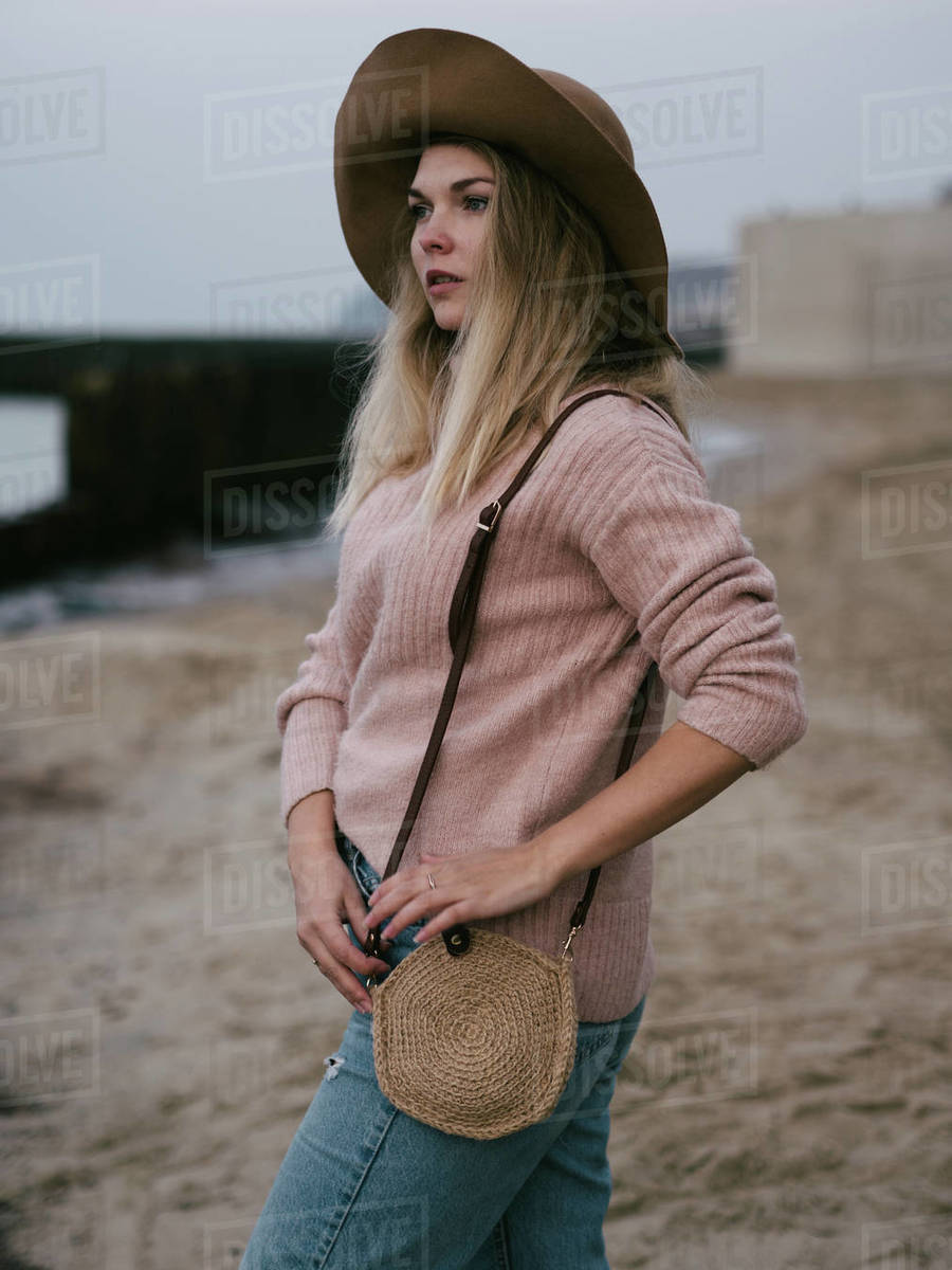 Girl in Hat at sea with a handmade jute bag Royalty-free stock photo