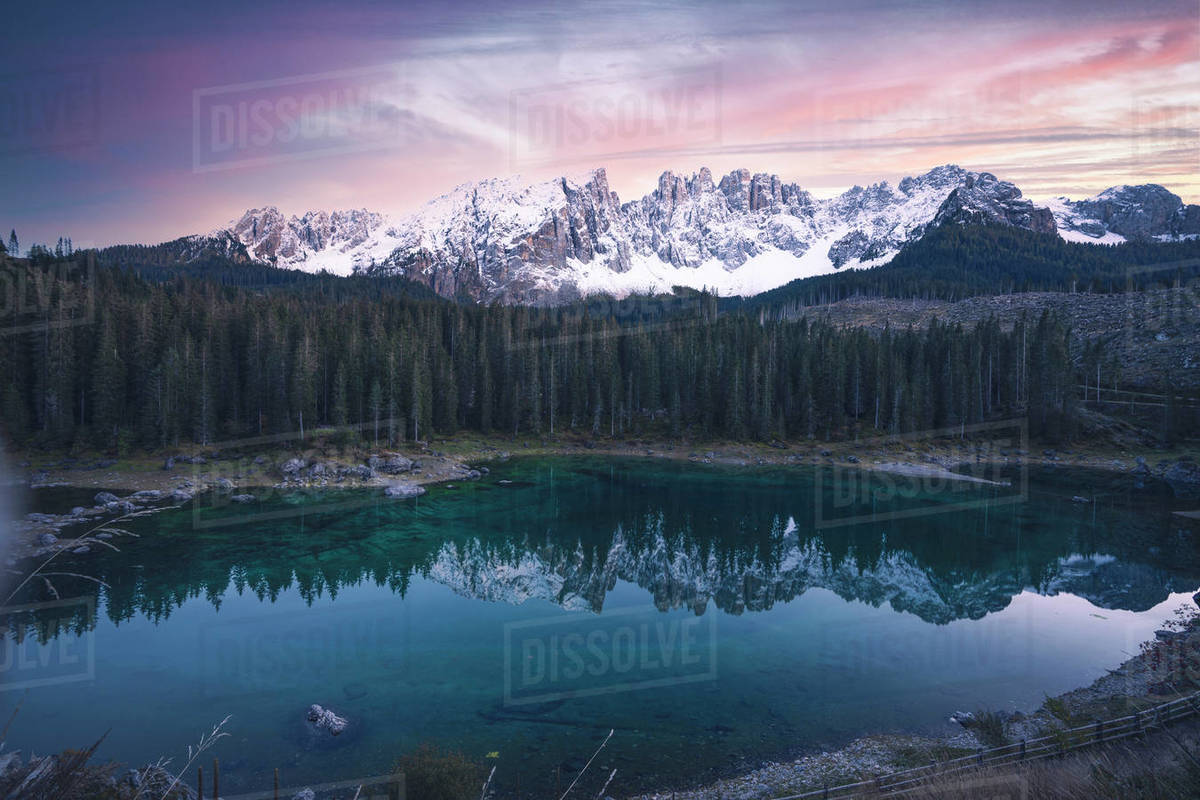 Landscape shot of Lago di Carezza in front of Latemar at sunset Royalty-free stock photo