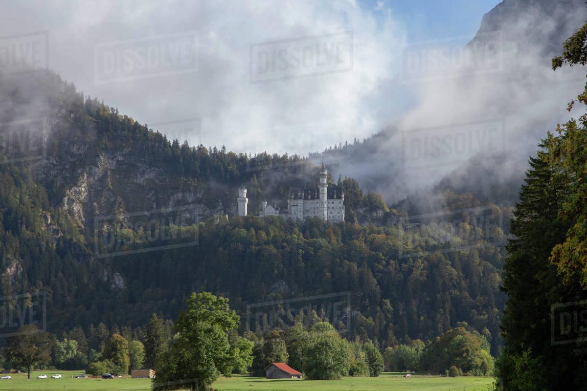 Castle Neuschwanstein in the mist. Royalty-free stock photo