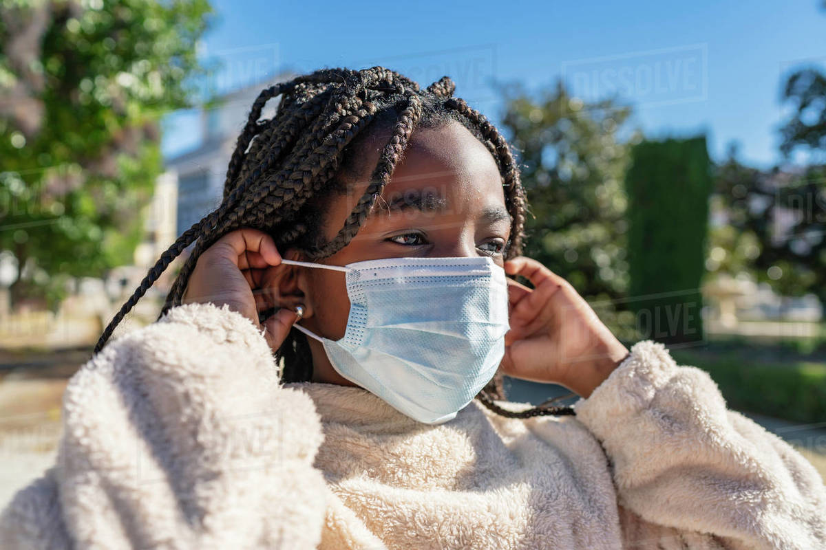 Beautiful african girl with a mask to avoid covid19 Royalty-free stock photo