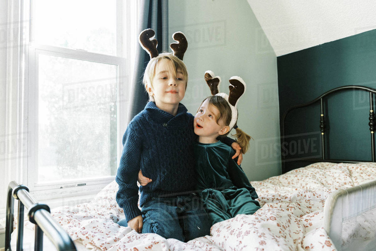 Two children talking about Christmas in their room Royalty-free stock photo