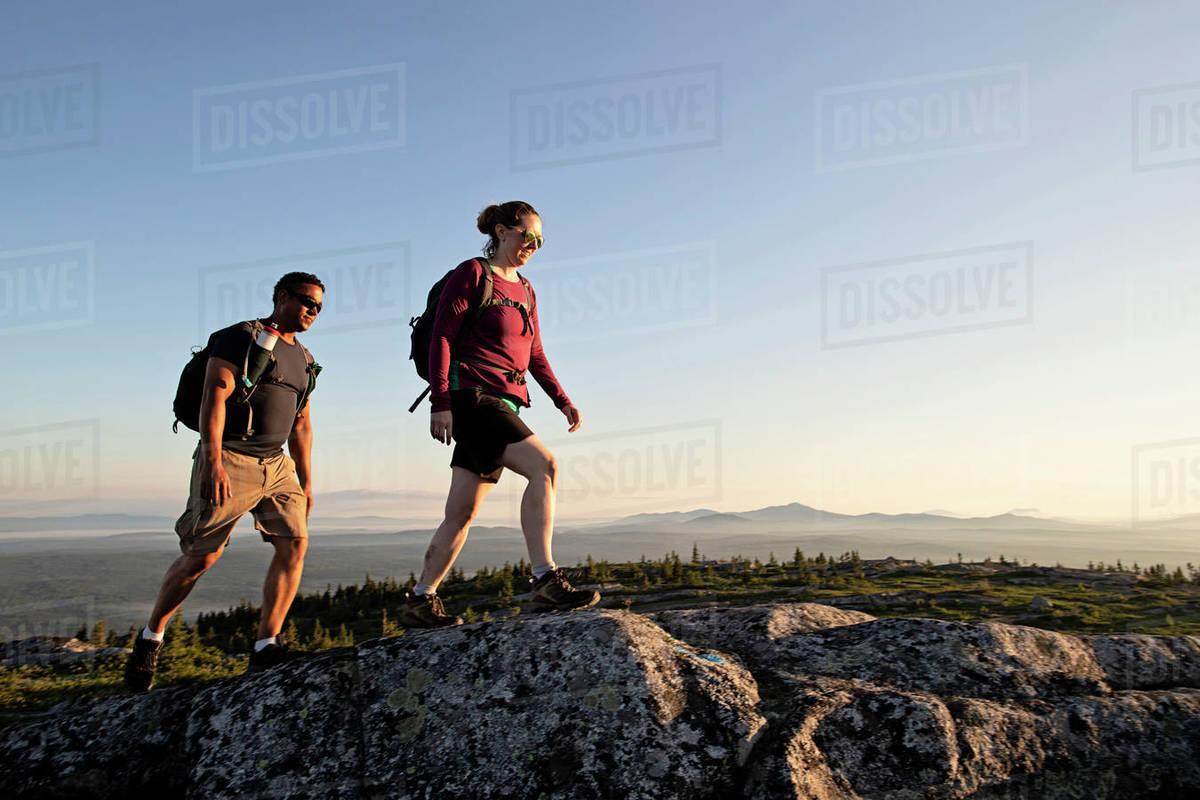 Multi racial couple reach summit of mountain, Appalachian Trail Maine Royalty-free stock photo