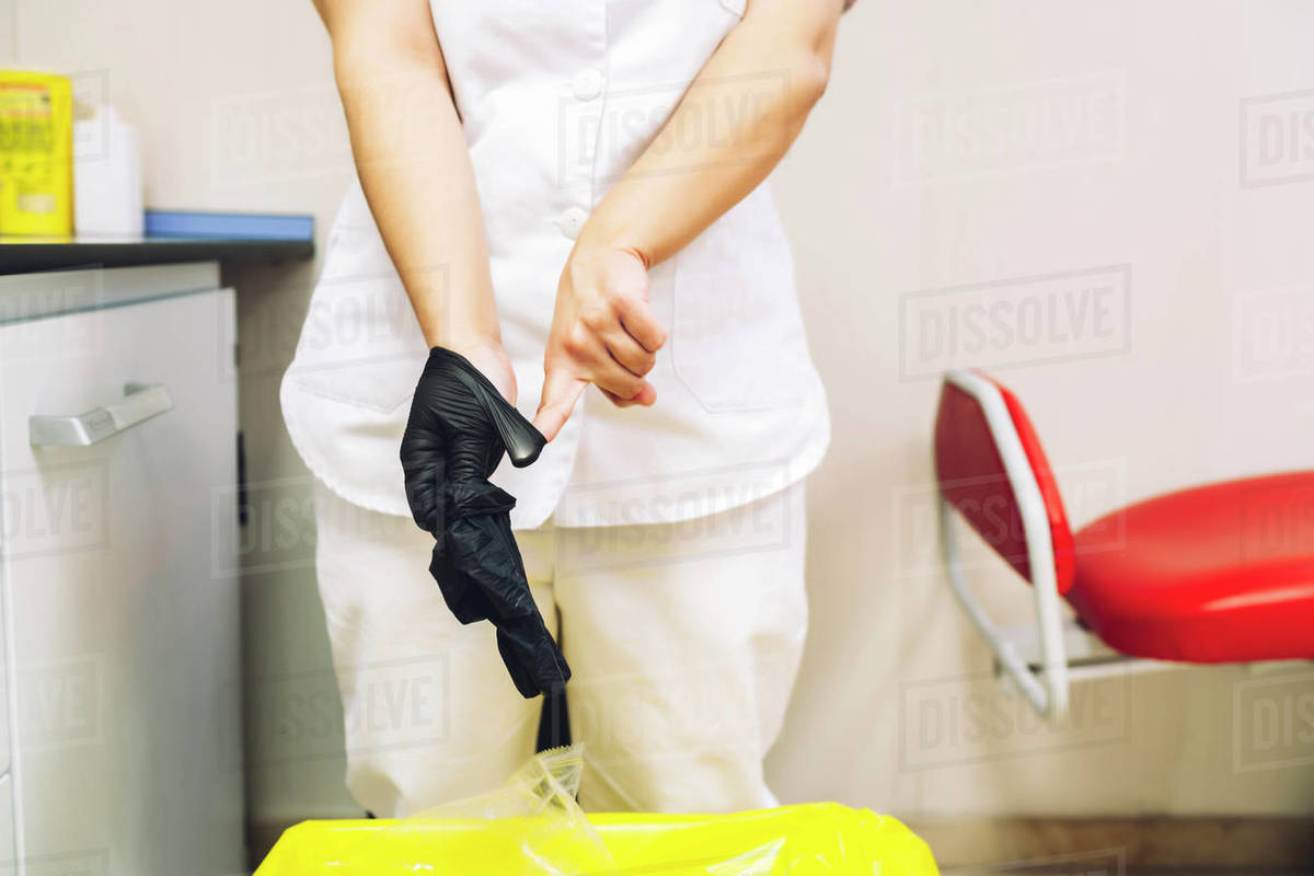 Female doctor pulling her work gloves Royalty-free stock photo