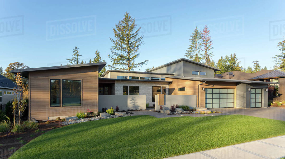 Contemporary luxury home exterior in late afternoon. Royalty-free stock photo