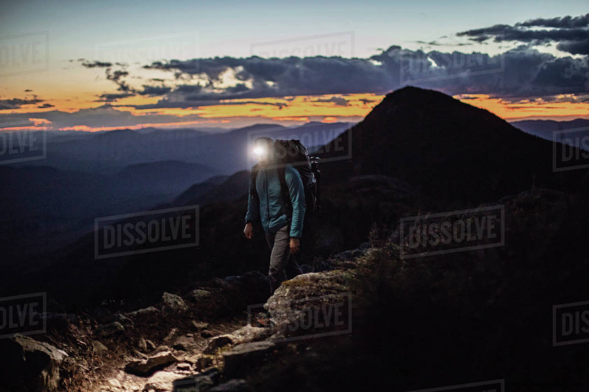 Hiker on mountaintop at dusk with headlamp, Bigelow, maine Royalty-free stock photo