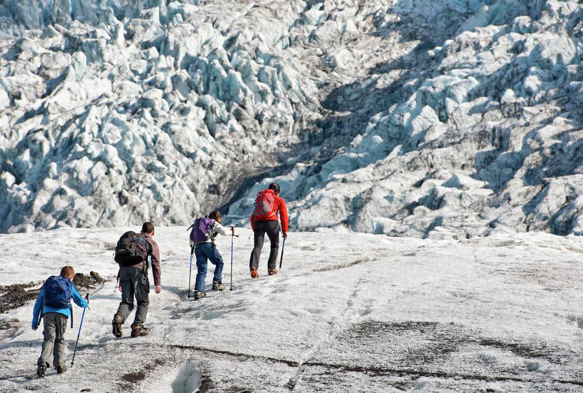 Family exploring the edges of Vatnajokull glacier in Iceland Royalty-free stock photo