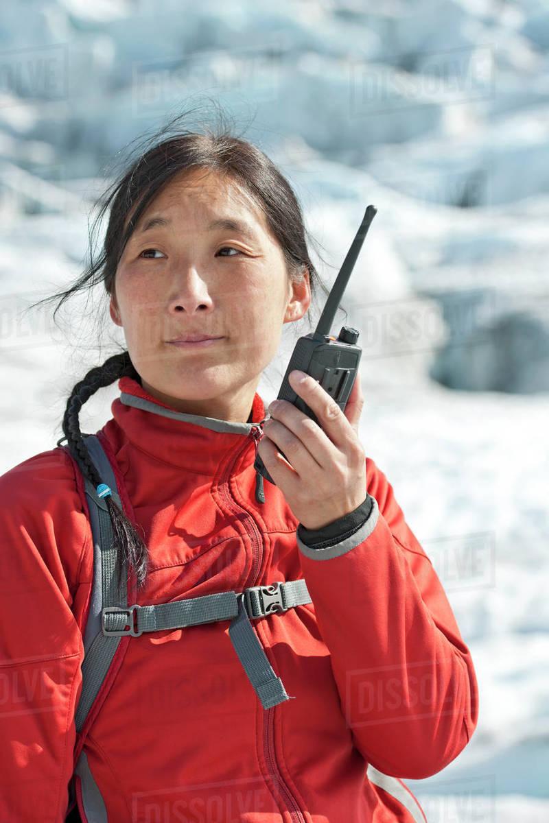 Woman using radio on Vatnajokull glacier Royalty-free stock photo