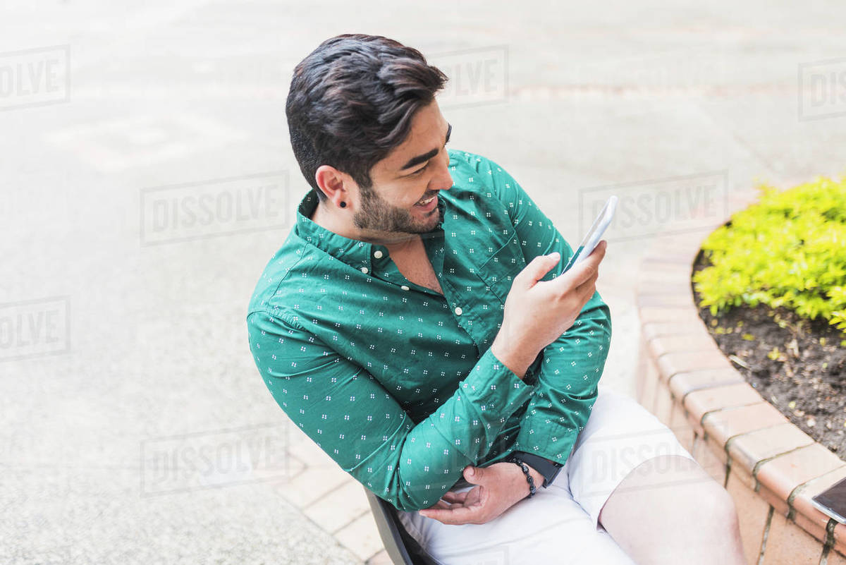Handsome man chatting on his smartphone Royalty-free stock photo