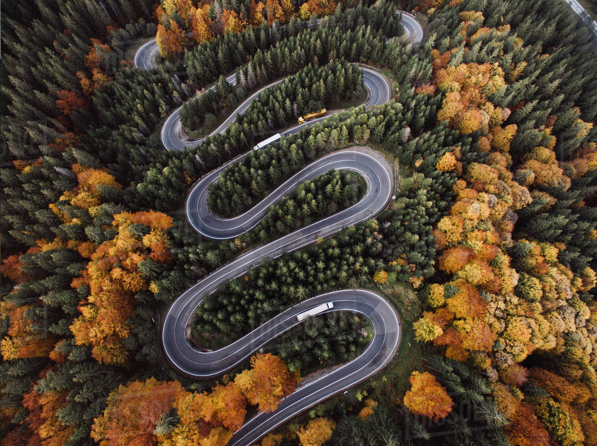 Aerial View of Epic Winding Road and Cars During Autumn Royalty-free stock photo