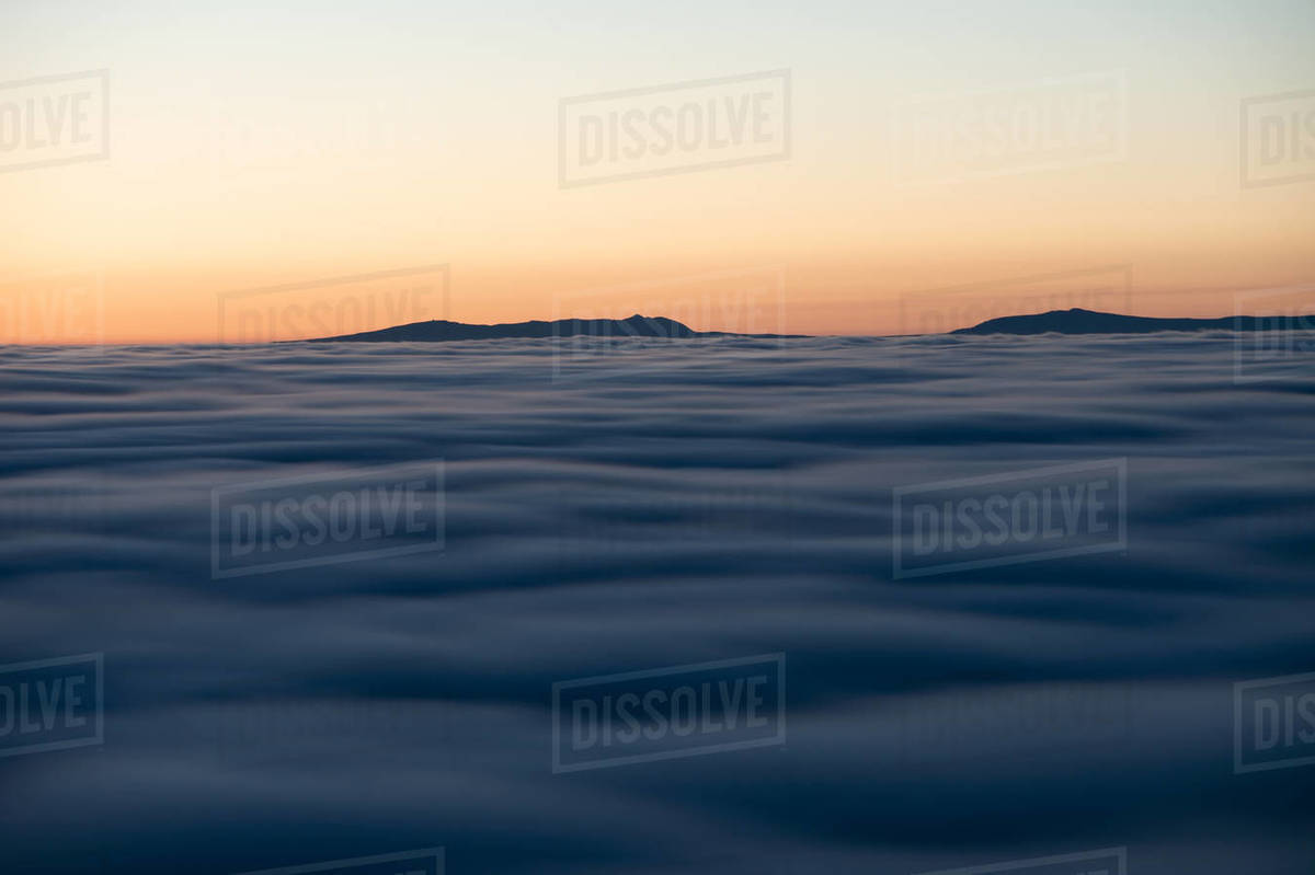 Abstract View Of Low Clouds at Sunset with Mountains in the Background Royalty-free stock photo