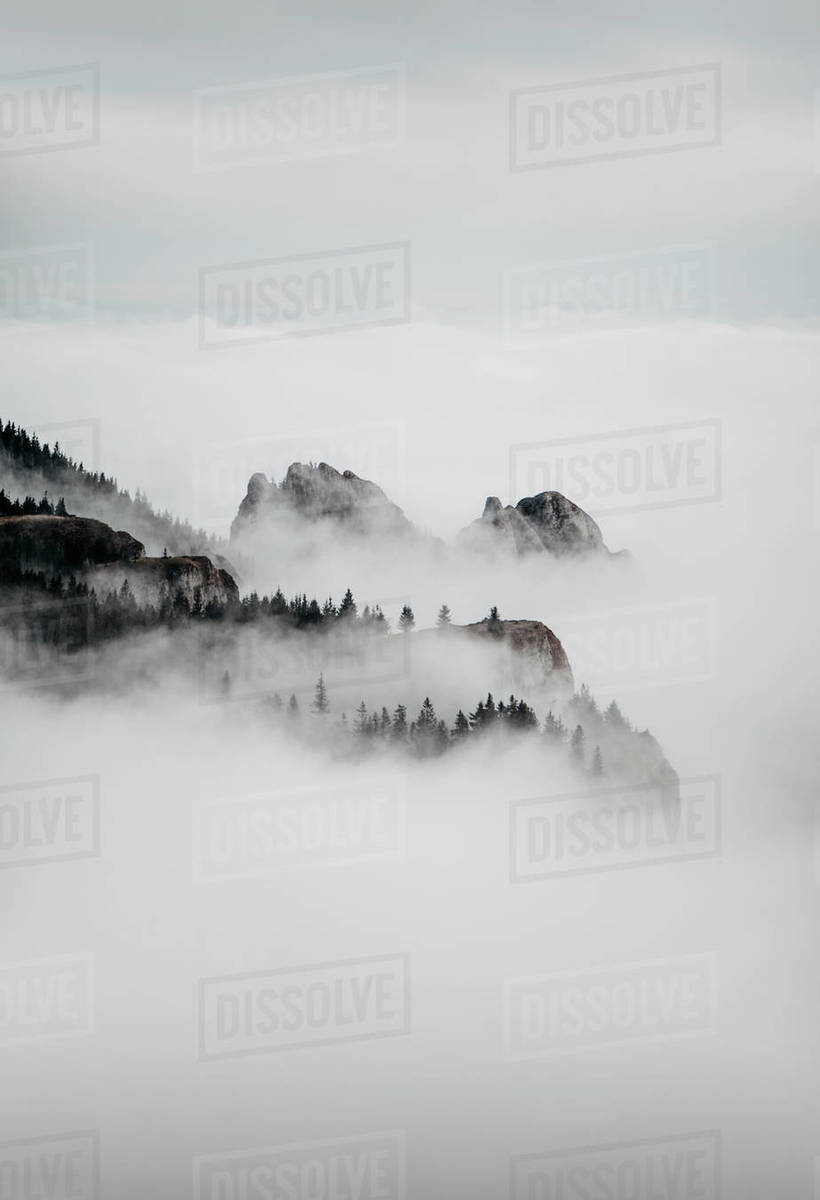 Silhouette of Mountains Covered in Fog During Winter Royalty-free stock photo