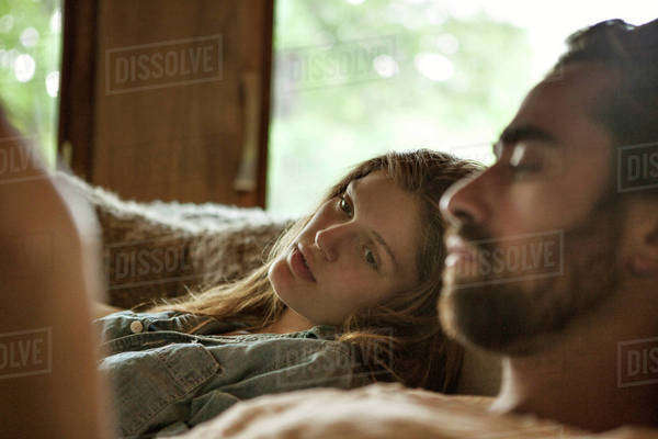 Couple relaxing on sofa Royalty-free stock photo