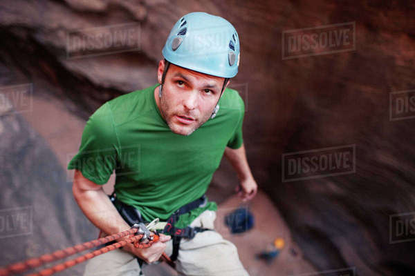 High angle view of man rappelling down from mountain Royalty-free stock photo