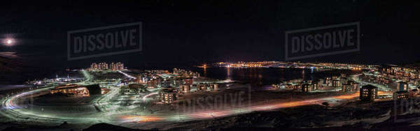 Panoramic view of illuminated city streets by sea against sky Royalty-free stock photo