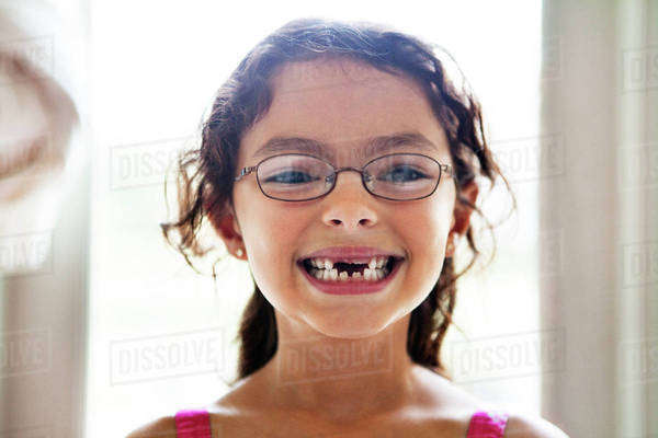 Portrait of smiling girl (6-7) with missing teeth Royalty-free stock photo