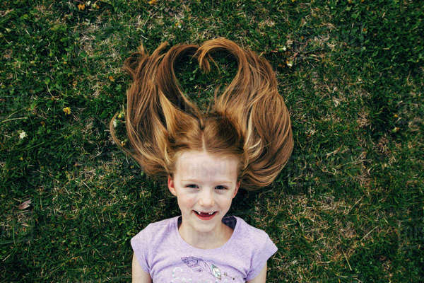 Portrait of happy girl lying on field Royalty-free stock photo