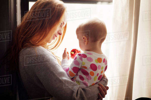 Young mother holding baby girl (18-23 months) Royalty-free stock photo
