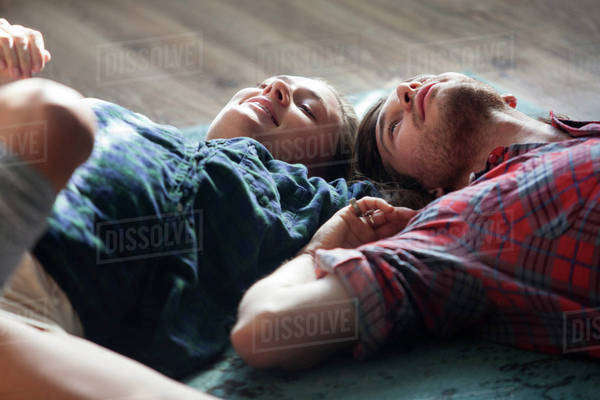 Young couple lying on wooden floor Royalty-free stock photo
