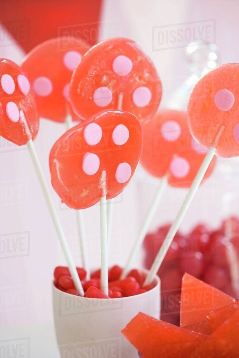 Homemade Lollipops in a Cup - Stock Photo - Dissolve
