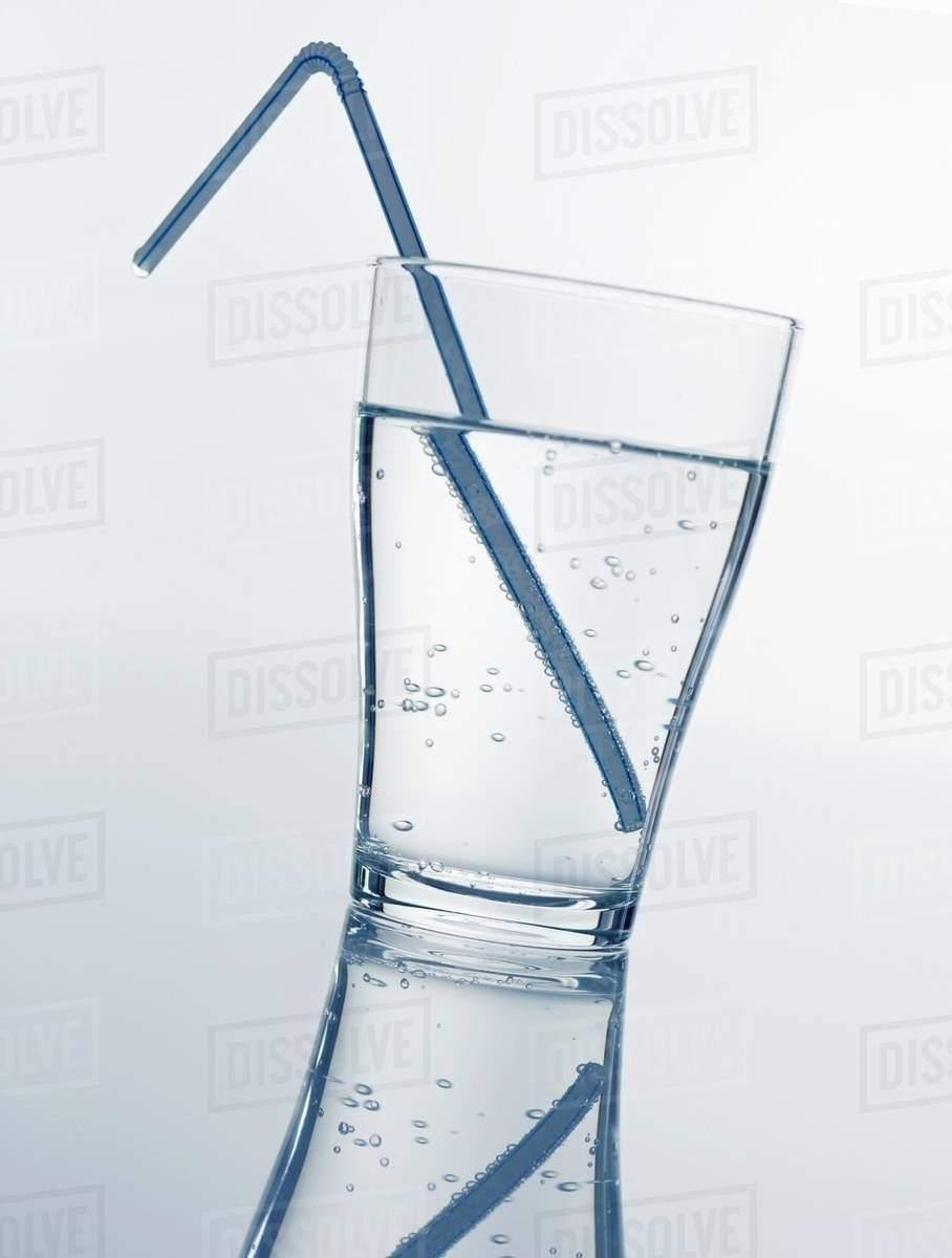 A glass of mineral water with straw Royalty-free stock photo