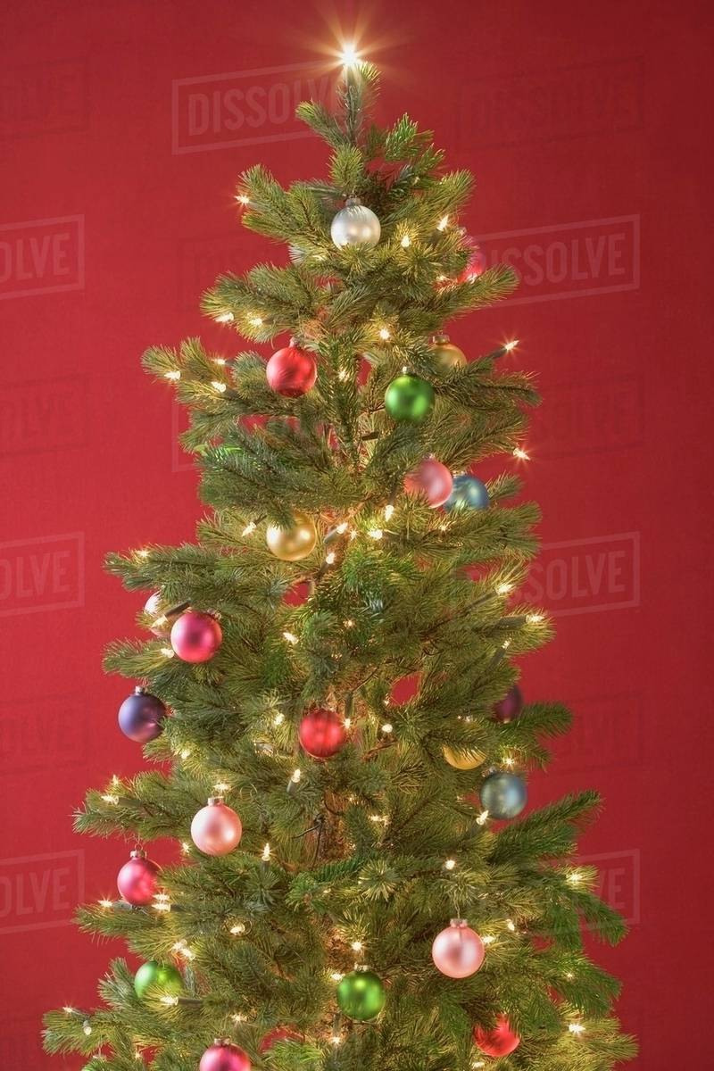 christmas tree with coloured baubles and fairy lights