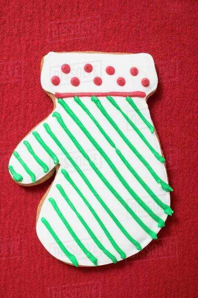 Iced Christmas biscuit (mitten) Royalty-free stock photo