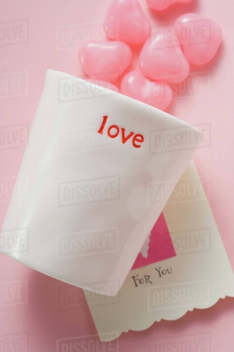 pink heart shaped sweets beaker and valentine card stock photo