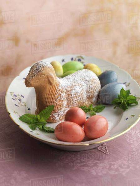 An Easter lamb with colourful eggs Royalty-free stock photo