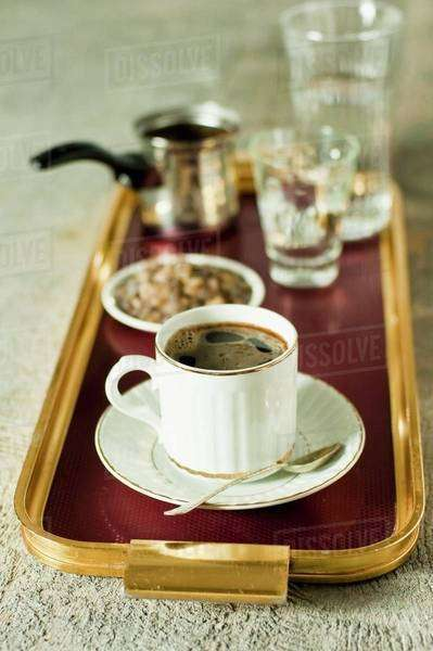 Turkish coffee and dark rock sugar on a tray Royalty-free stock photo