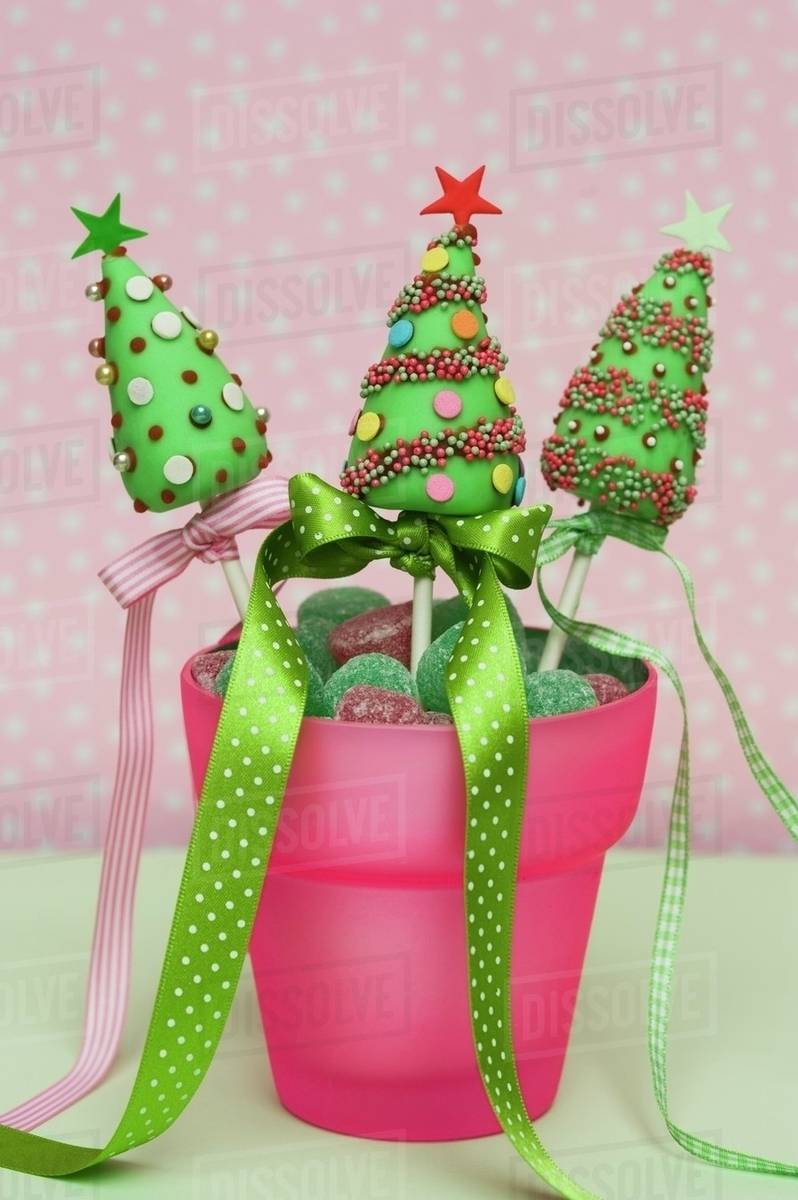 Christmas Cake Pops.Christmas Cake Pops In A Pot With Candies Stock Photo