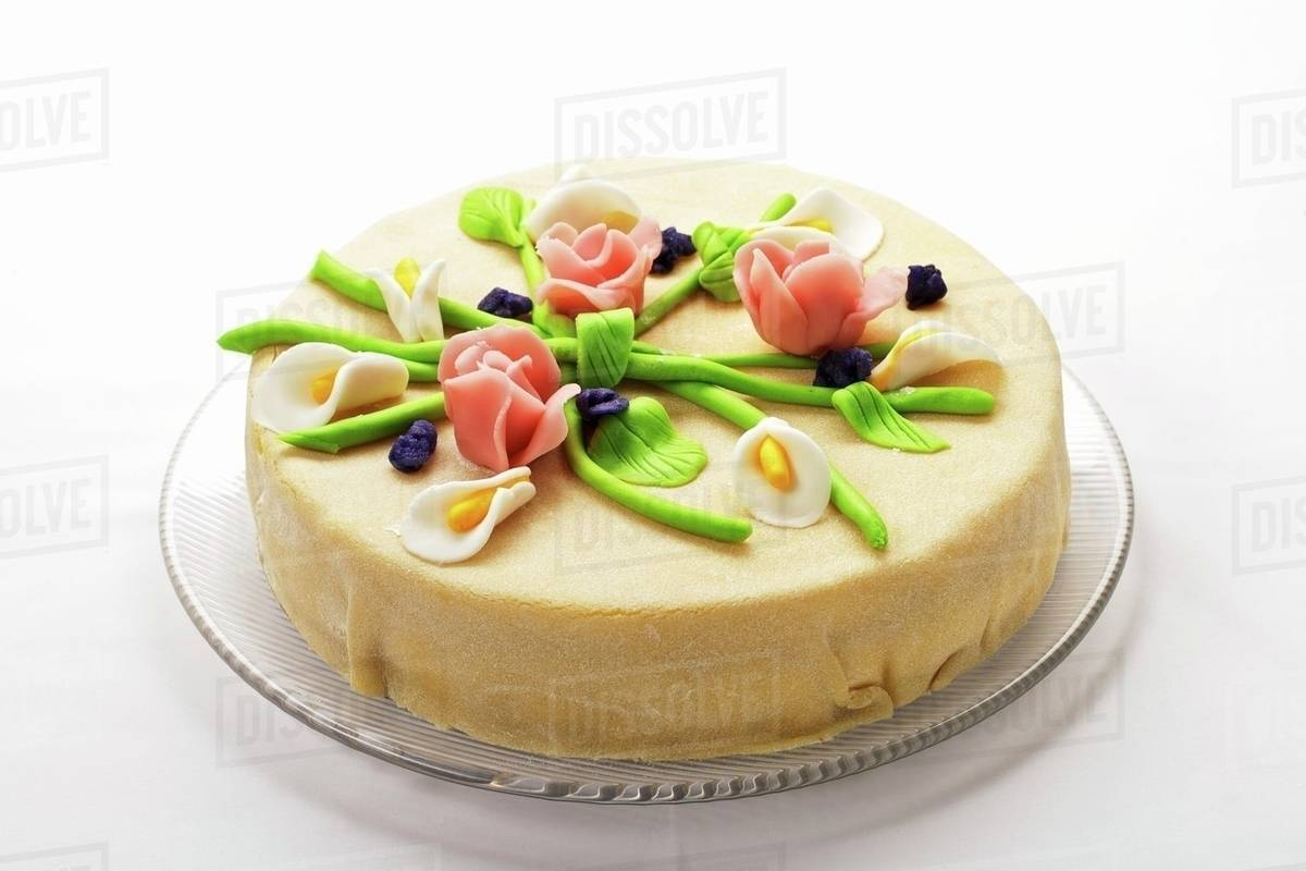 Elegant marzipan layer cake with marzipan flowers - Stock Photo ...