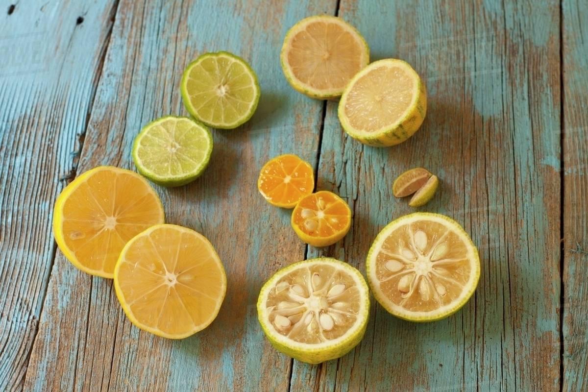 Assorted Citrus; Meyer Lemon, Yuzu, Finger Limes, Calamondin, Kaffir Lime, Variegated Pink Lemon Royalty-free stock photo