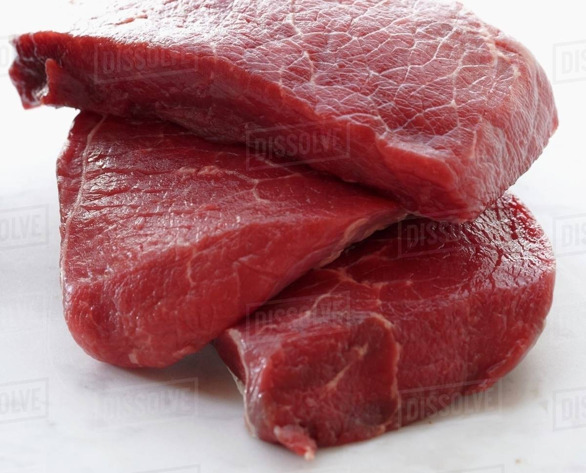 Raw Beef Stacked - Stock Photo - Dissolve