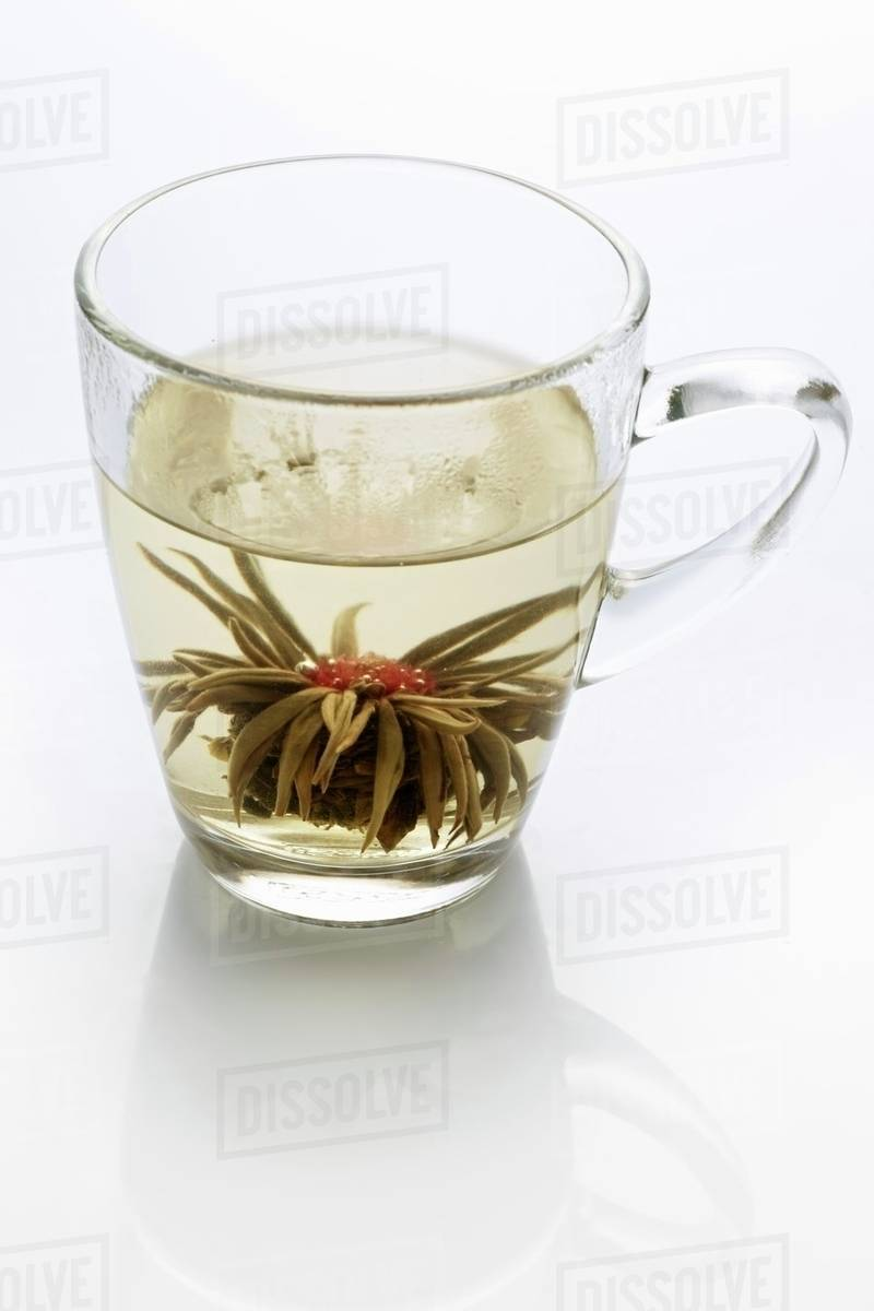 A Glass Of Jasmine Tea With A Tea Rose Stock Photo Dissolve