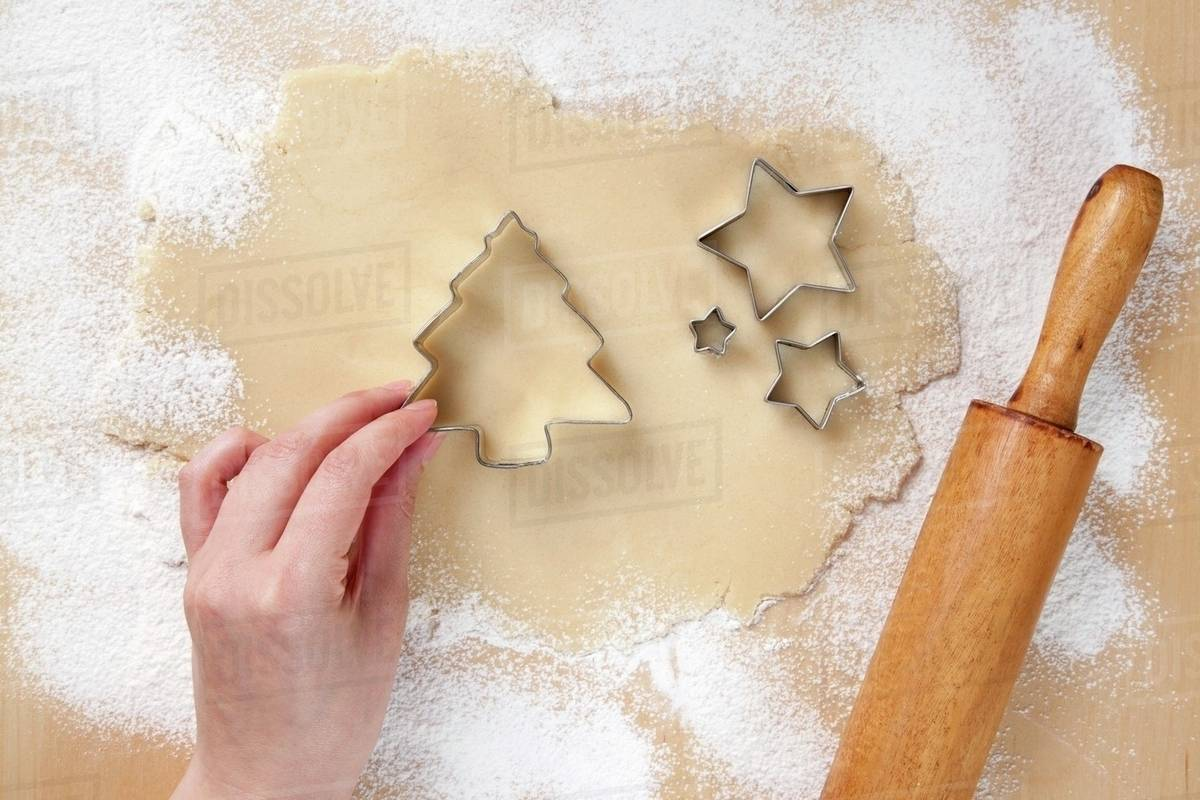 Hand Placing Christmas Tree Cookie Cutter On Rolled Out Cookie Dough Star Cookie Cutters Stock Photo