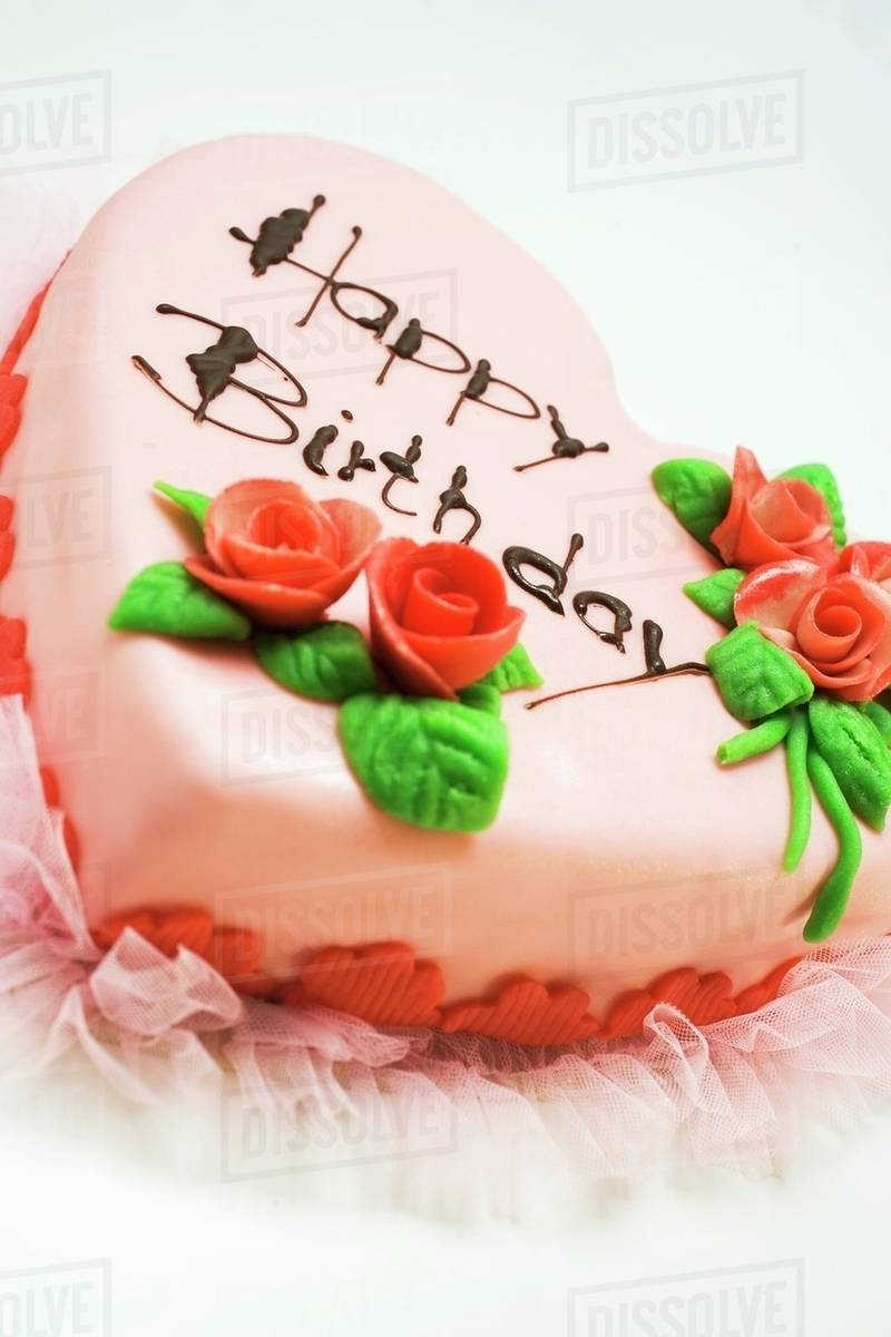 Pink heart-shaped birthday cake with marzipan roses - Stock Photo ...