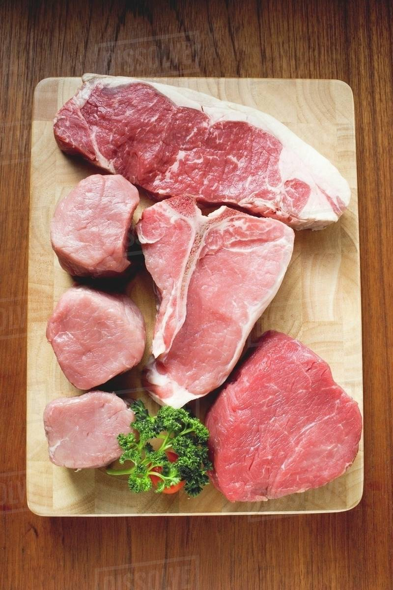 various types of beef steak and pork fillets stock photo dissolve