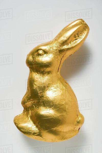 Chocolate bunny in gold foil Royalty-free stock photo