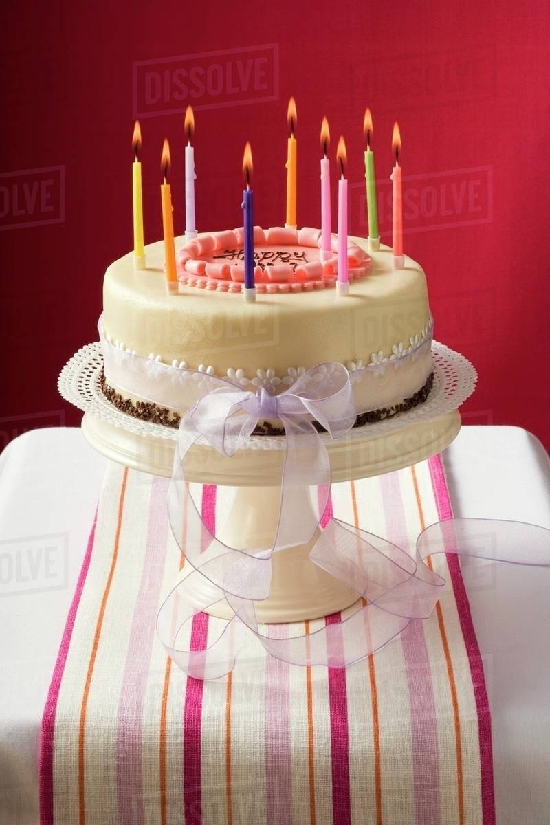 Birthday Cake With Burning Candles On Stand