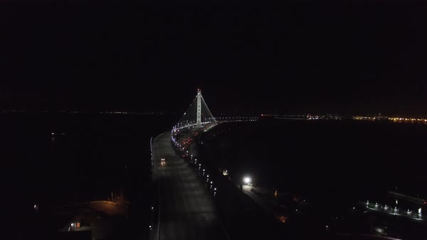 Aerial video approaching the new Bay Bridge at night Royalty-free stock video